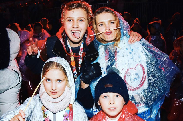 Natalia Vodianova with children is attending the Special Olympics in Austria