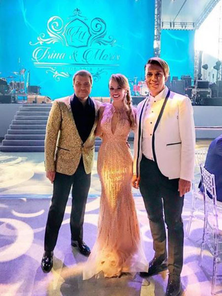 Nikolay Baskov and Maxim Galkin with a wedding guest