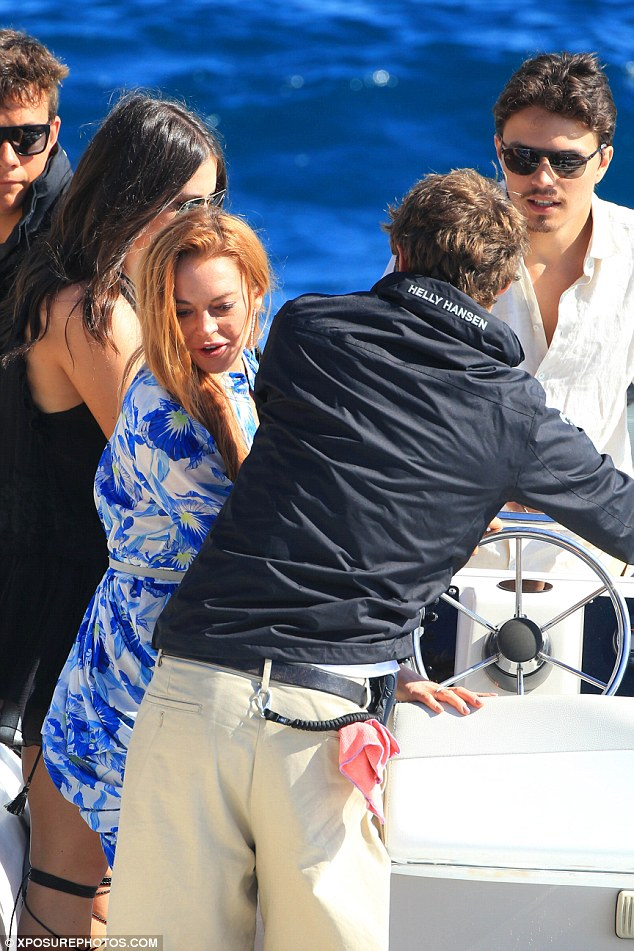 All aboard the love boat! Lindsay and Egot seemed in great spirits as they jumped onto the speedboat