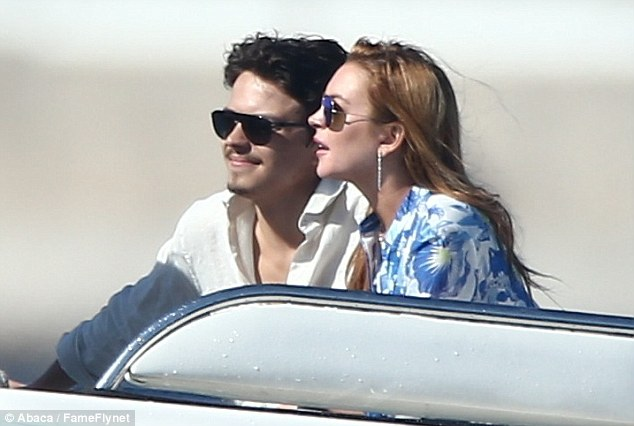 Cruising through Cannes: The pair cuddled up on the speedboat which picked them up from their hotel