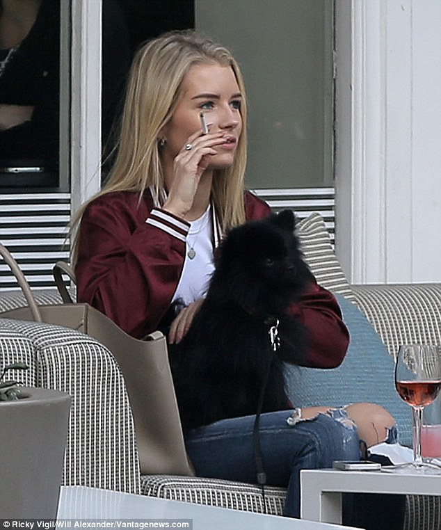 Having a toke: Kate has long been known to be pictured with her beloved Marlboro Lights, often puffing away both away from the camera and in front of it - yet Lottie's tobacco habit is a new development